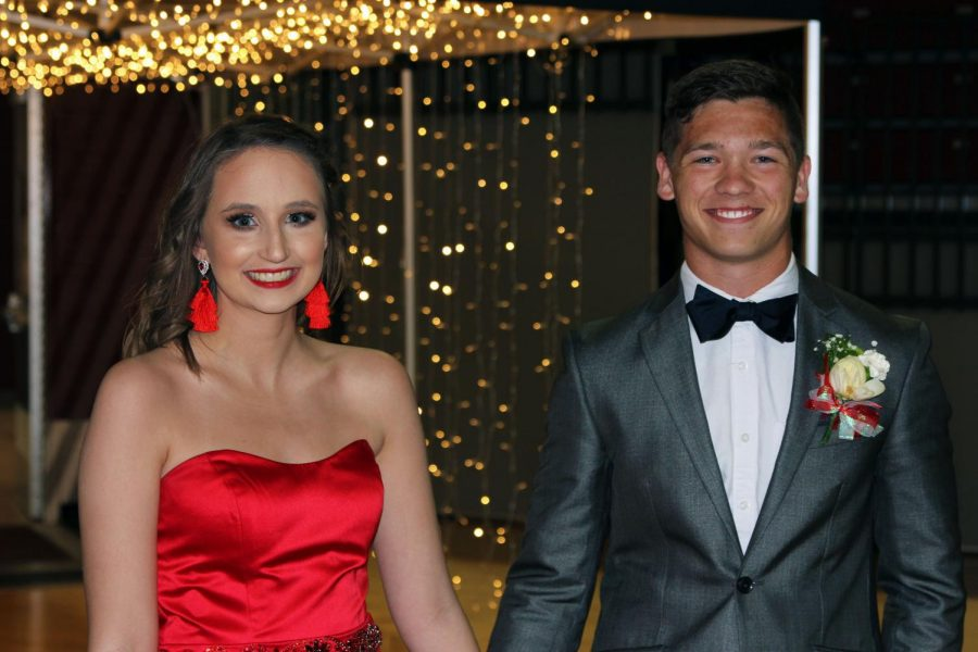 Senior Sydney Gadberry and junior Braxton Brown arrive at prom under the lighted entryway.
