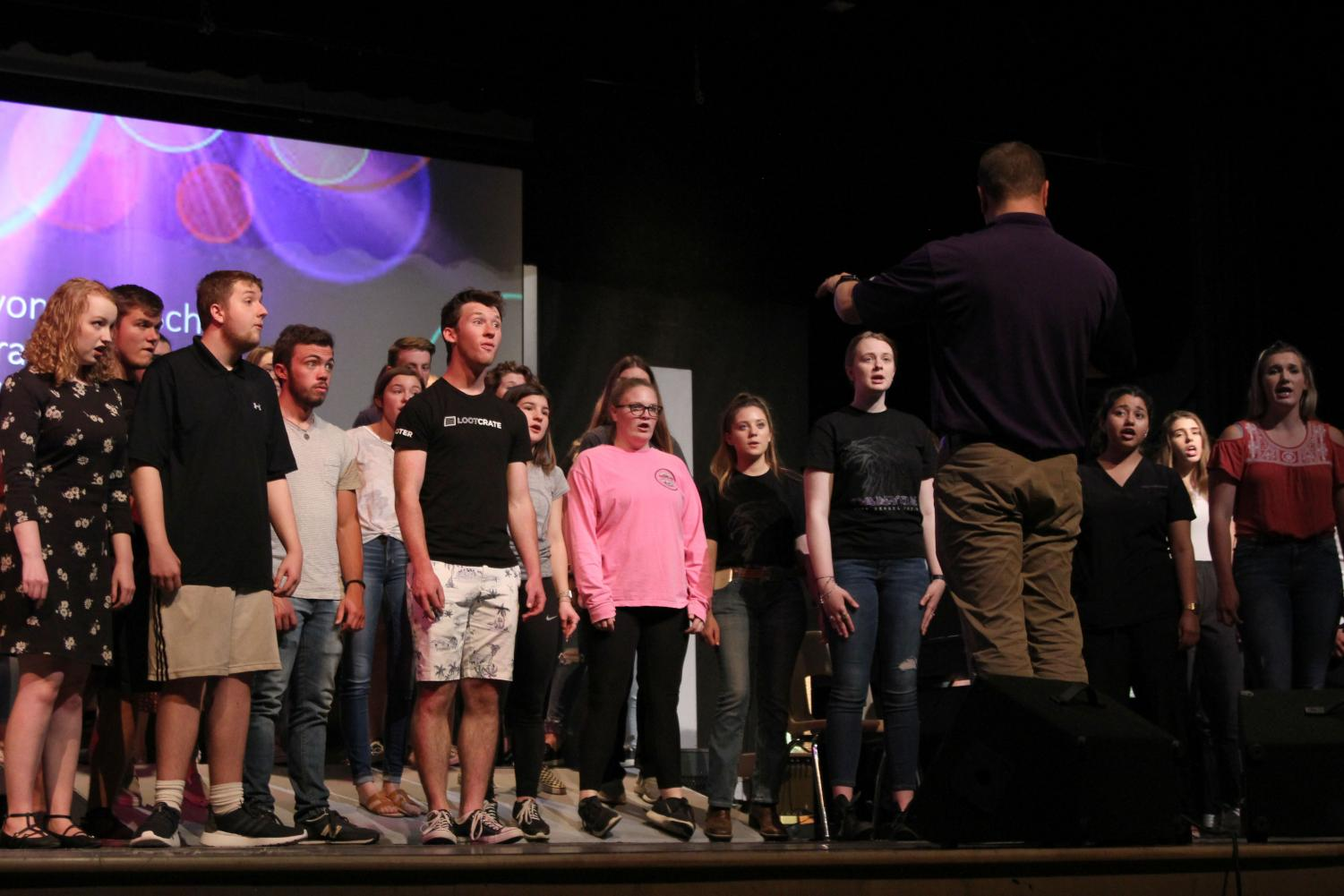 The varsity choir rehearses Monday afternoon for their annual variety show concert.
