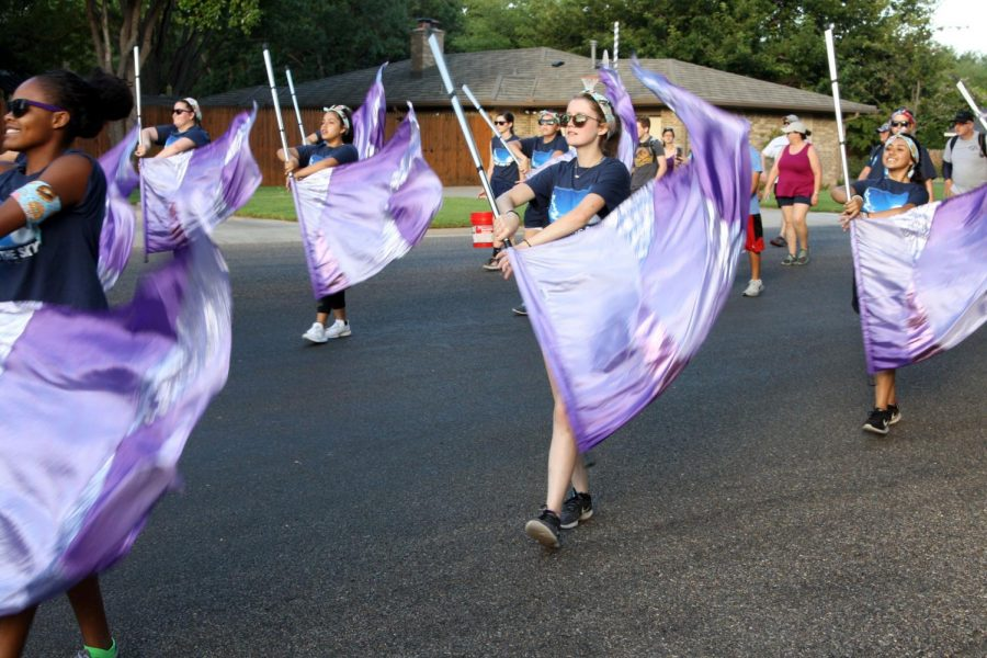 Junior Kodi Hicks flags while the band performs the fight song.