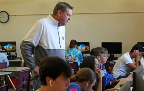 Coach teaches life skills on courts, keyboards