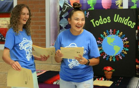 Spanish Club Publicist Madeline Shadduck and Vice President Chloe Balderaz hand out promotional flyers during a club fair.