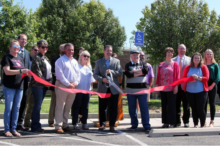 Joined+by+other+school+board+members+and+school+personnel%2C+board+president+Bruce+Cobb+cuts+the+ribbon+at+the+Career+and+Technology+Academy+Sept.+24.+