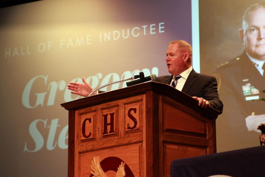 Greg Stevens, class of 1988, addresses juniors and seniors at the assembly.