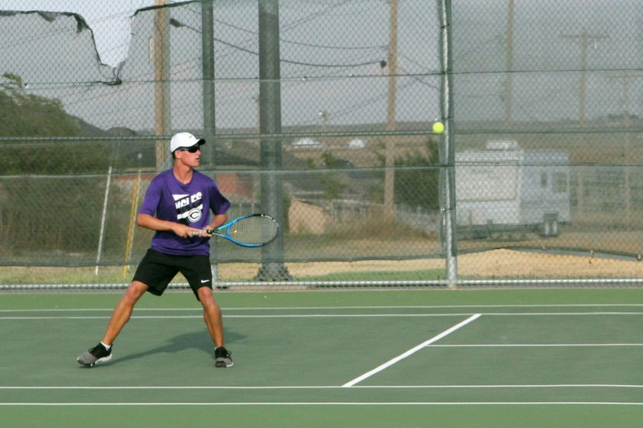 Playing a match in September, junior Shane Neal prepares to return the ball.
