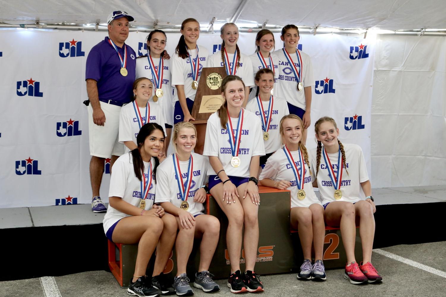 The girls cross country team celebrates their state championship in Round Rock Nov. 9.