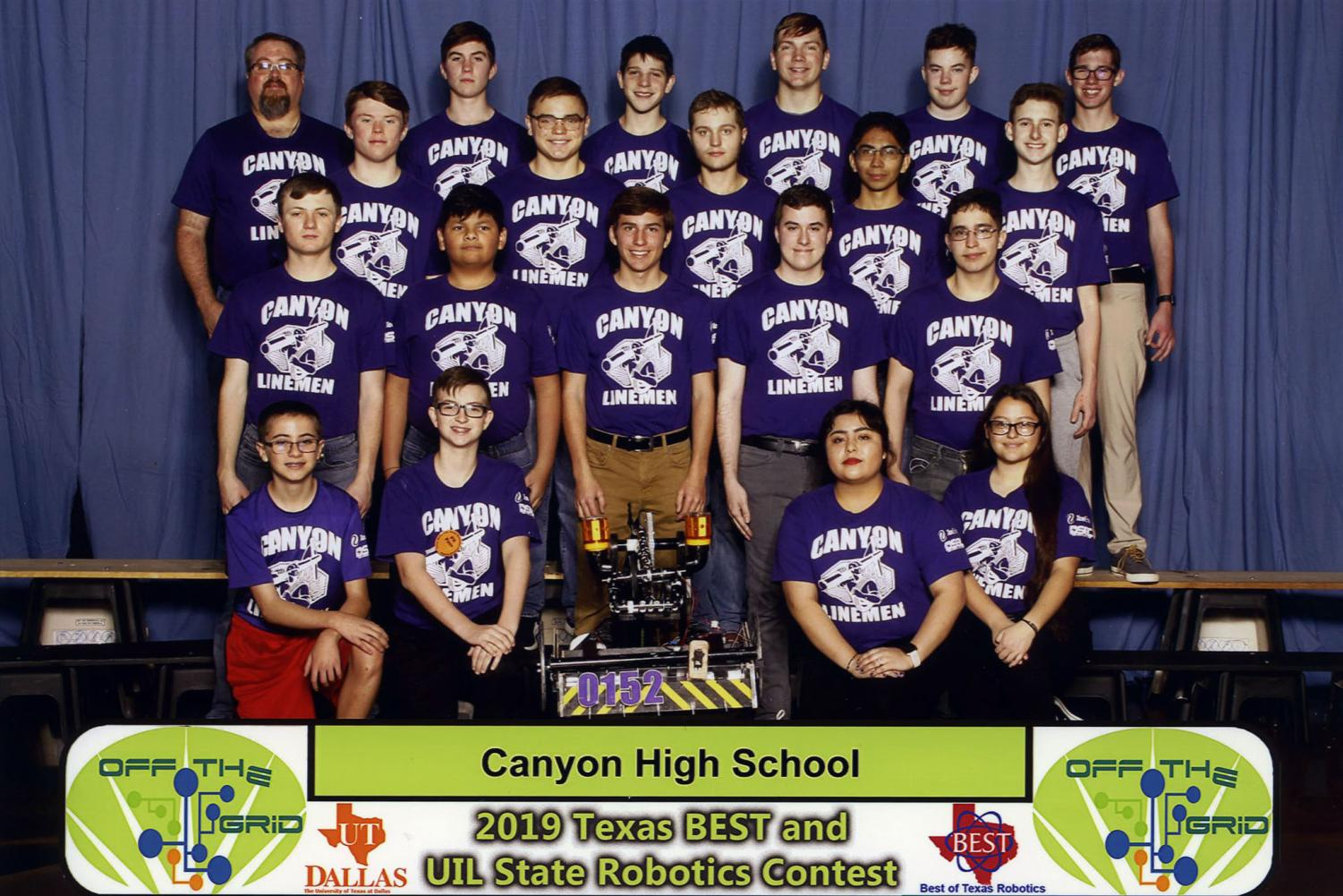 The robotics team with the robot F.U.L.G.O.R.A. (Fully Functioning Utility Line and Grid Operational Reattachment Apparatus), named after the Roman goddess of lightning.
