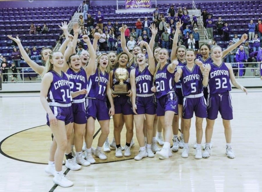 The Lady Eagles celebrate their area championship after defeating Dalhart at the regional tournament.