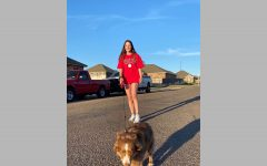 "Senior Halle Kennedy takes her dog, Maddox, on walks for him to exert his energy. ""He has ADHD, and he hates squeaky chew toys,"" Kennedy said. ""It"