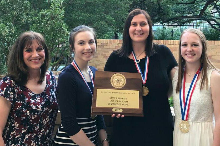 Journalism adviser Laura Smith accompanies graduates Erin Sheffield, Callie Boren and Sarah Nease after winning a UIL state championship in 2017.