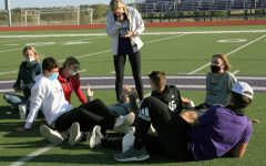 Members of the Fellowship of Christian Athletes meet in a small group to discuss strategies to follow Christ at their first meeting in September. FCA meets on the football field at 6 p.m. every Monday, and all Christian denominations are welcome.