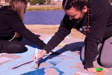 The Texas Art Education Association's Art in the Park chalk competition attracted 50 Canyon students competing as individuals, duos and trios on Saturday, Oct. 17. Taking home the Peoples Choice Award and a $100 cash prize for their work; duo team, sophomores Raylee Fernandez and Taryn Gullick, paint their abstract, award winning entry.