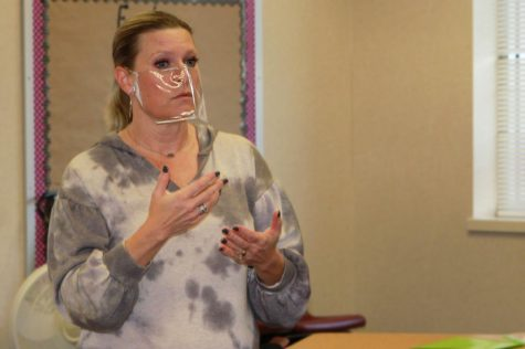 American Sign Language teacher Sarah Martindale signs to students during her first period class. Martindale began teaching at Canyon High School after spending five years teaching in Miami, Texas.
