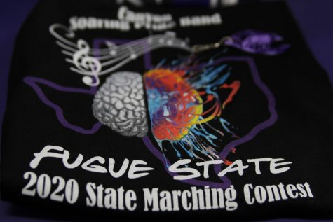 In preparation for State, the Soaring Pride Band boosters provided T-shirts to all band members. The shirt includes themes from the show as design elements.