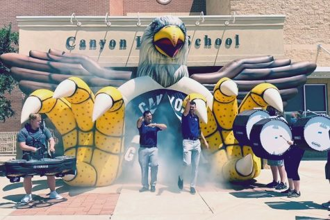 Assistant principals Blake Hurst and Eric Gomez storm out of the Eagle's Tunnel while members of the Soaring Pride Band Drumline perform a cadence. The duo have worked together at Canyon High for the last two years, earning themselves the title of