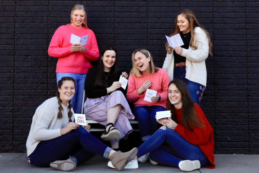 Seniors Danielle Burns, Kelsey Braudt, Kathryn Culbert, Hannah Hamil, Mallory Wright and Aubrey Thomas show off handmade Valentine's cards created by Wright. She sells cards through her business, The Wright Words Card Company. With premade cards available for purchase, Wright also offers custom cards.