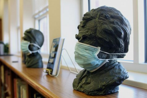 Sitting atop a shelf of library books in the nonfiction section of the learning commons, a statue head is adorned with a paper face mask. According to the Centers for Disease Control and Prevention, those over the age of two should wear a face mask while in a public setting or around people who do not live with the person. However, masks are not a substitution for social distancing. Staying six feet apart from others while indoors is advised. The CDC actively studies face masks and the effectiveness of mask variants and continually updates the public on their website, cdc.gov/coronavirus.