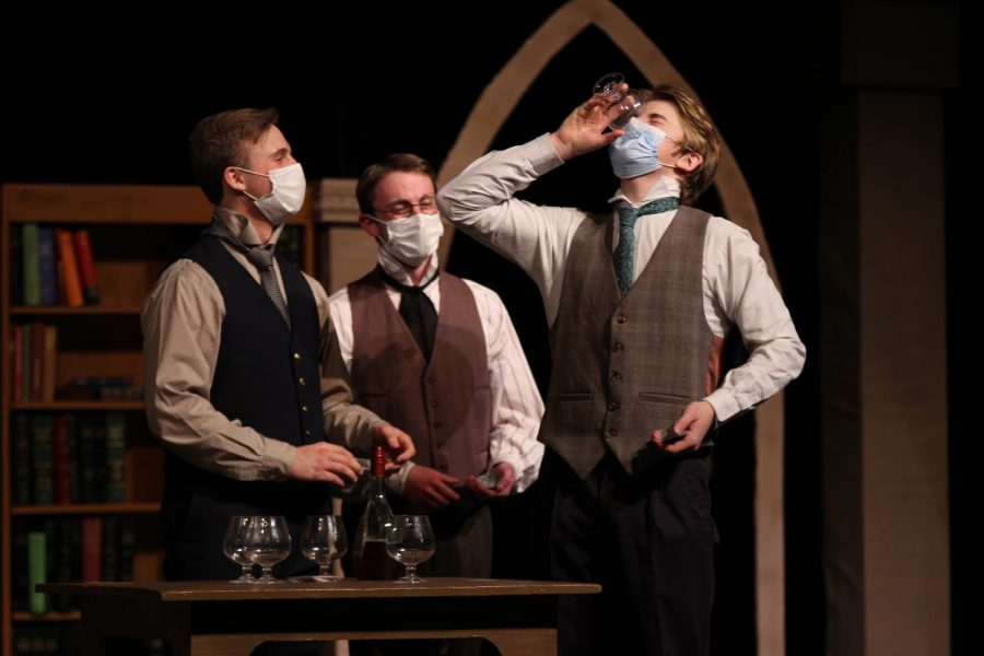 """In this """"drinking scene,"""" the group of guys are playing a card and drinking game, where Edwards keeps losing the game and has to take another cup of Brandy. Senior Lane Miller plays supporting character Holmes. Holmes is a student at Girton College, University of Cambridge, which is the main setting. """"I relate to my character because he's caught up in his passion as a student, but also the intense politics of the time,"""" Miller said. """"I definitely relate to his studious aspects and his desire for cleanliness."""" Miller said he joined One-Act because he loves to act and wanted to do something with his time in highschool. """"One-Act has helped me gain confidence in myself and my beliefs as a person,"""" Miller said. """"It offered such a supportive, encouraging community and is an outlet for me where I get to make some great art with that community."""""""