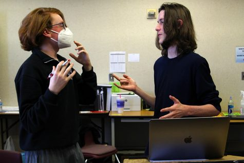 "Senior Ryan Cox and freshman Liam Stayton argue about their strategy in a mock debate. The pair competed at the UIL State Championships over spring break, winning two of their rounds. ""We practice Tuesdays and Thursdays after school,"" Cox said. ""We put in so many hours because we want to be the best possible. Even though we work hard, we always try to keep it light. We"