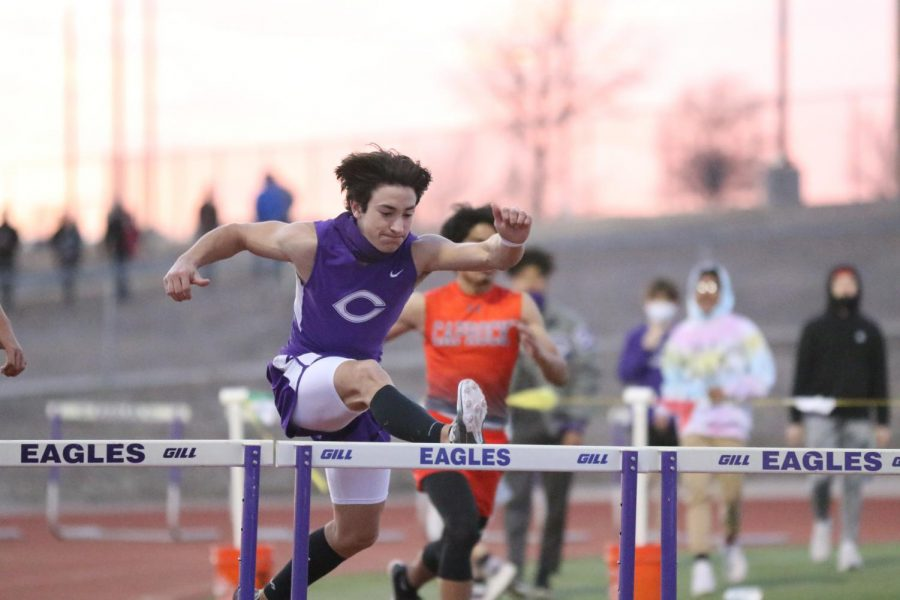 """Sophomore Seth Green runs the 300 meter hurdle. """"20% of the time we all mess around and joke with one another,"""" Green said. """"The rest of the time we are really focused and work our hardest on becoming the best we can be. Hurdles are all about form and practice."""""""