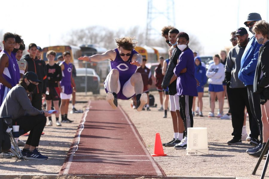 """Senior Sean Thompson in the long jump competition. """"There are always things that you need to work on as an athlete, that includes mental and physical abilities,"""" Thompson said. """"During the lows you need to focus and practice, the harder you work the better you get."""""""
