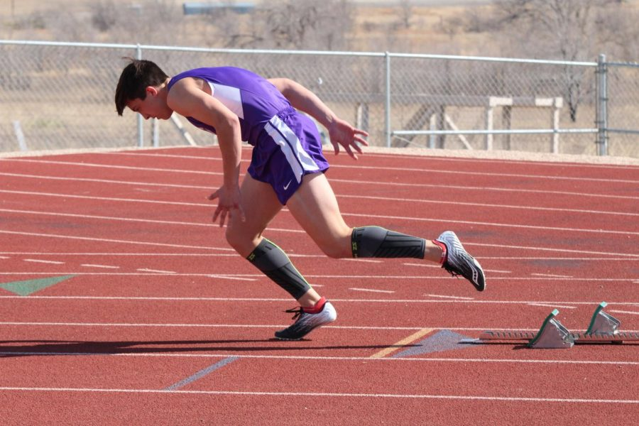 """Junior Ford Bobo launches himself into running the mile relay. """"I love to be around all my friends at a track meet, Bobo said. Normally, the meets are around eight hours long, so we get a lot of time to go and be around friends. Other than friends the thing that motivates me the most is winning. I hate losing. Working hard and training will make me the best I can be."""""""