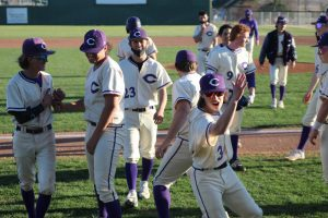 Ending the game against Perryton on March 26, baseball players celebrate their 11-1 win. Throughout baseball games, songs each player picked will play over the speakers as they approach the plate to bat.