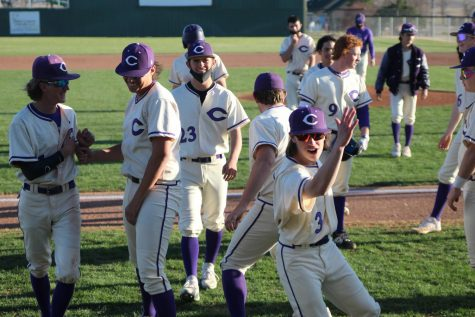 "Ending the game against Perryton on March 26, baseball players celebrate their 11-1 win. Throughout baseball games, songs each player picked will play over the speakers as they approach the plate to bat. ""I started trying to find a song back in March, a year ago,"" senior Trent Hefner said. ""It"