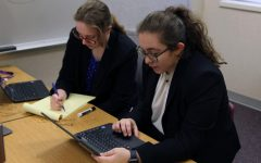"Senior Caroline Ragland and freshman Maleena Barrientos compete in their third round of the West Texas National Qualifier Tournament. This is the pair's first year debating together, and the two have spent the majority of the year attending online tournaments because of COVID-19 restrictions. Barrientos said the partners debate in suit jackets and sweat pants because they only speak sitting down at computers. ""Debating on computers is different in terms of giving information,"" Barrientos said. ""You communicate in a whole new way. Debating is still fun though. We argue about legislation and how things get done in government. The topic this year is about federal reform on the criminal justice system and how we can solve problems when it comes to policing, sentencing or forensics. I can uphold my opinions in a manner where it's fun, but we're talking about things we can change."""